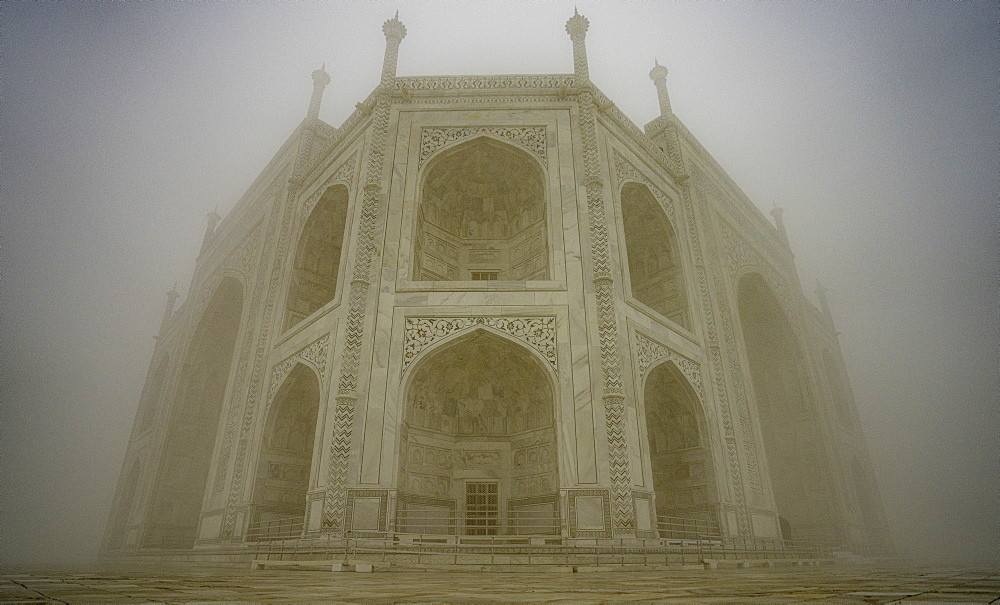 The Taj Mahal on a foggy morning. Agra, India - 1320-27