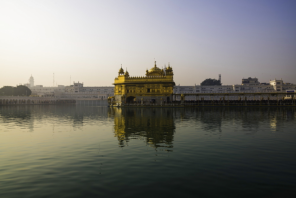 The Golden Temple at sunrise through fog. Amritsar, India - 1320-30