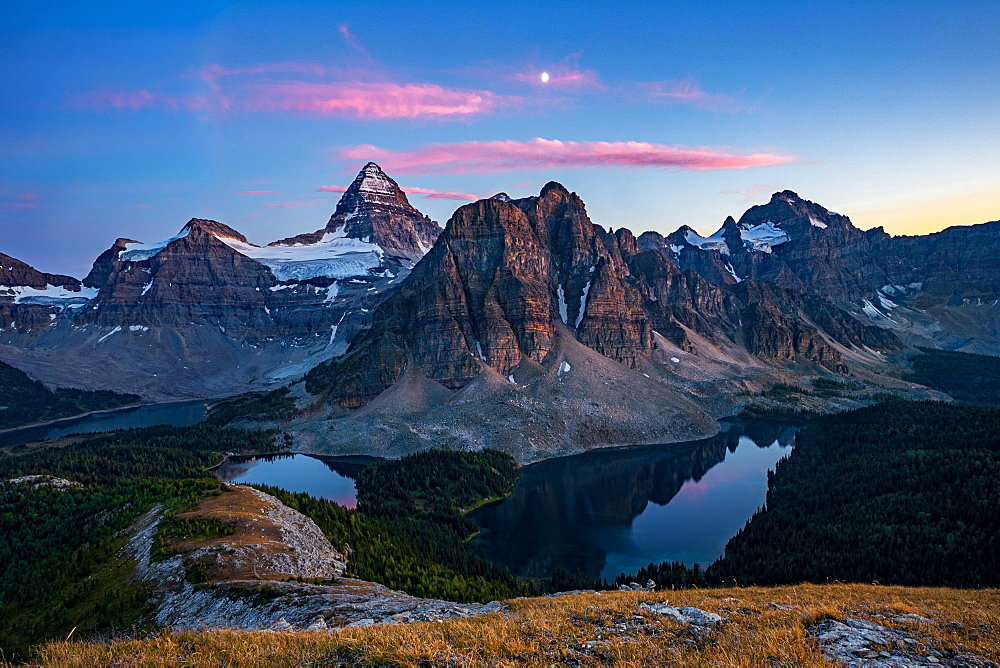 Sunset on top of Nub Peak, looking at Mount Assiniboine and the moon, Mount Assiniboine rises nearly 1525m above Lake Magog, Alberta, Canadian Rockies, Canada, North America - 1322-2
