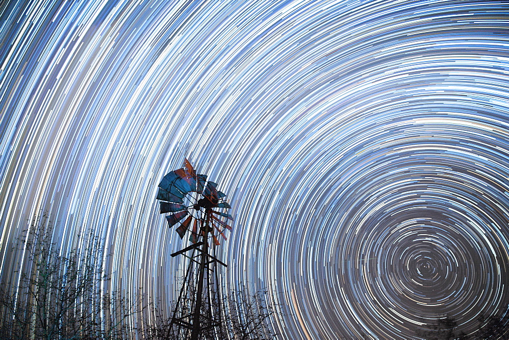 Startrail with windmill in foreground, Timbavati, South Africa, Africa - 1323-1