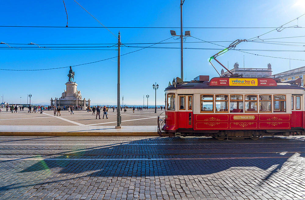 Traditional red Tram in Commerce Square, Lisbon.