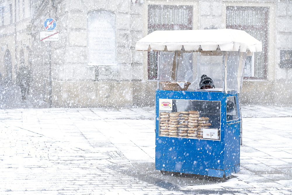 Traditional Krakow Bagel seller in the snow loacted at the City Square