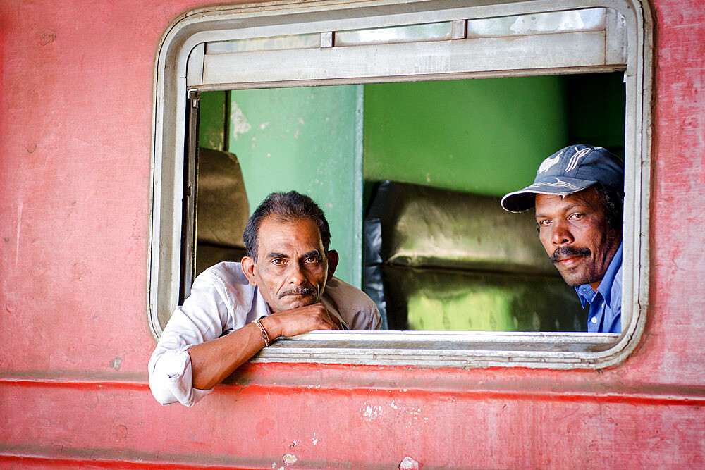 Two men on a train, Ella train station, Sri Lanka, Asia