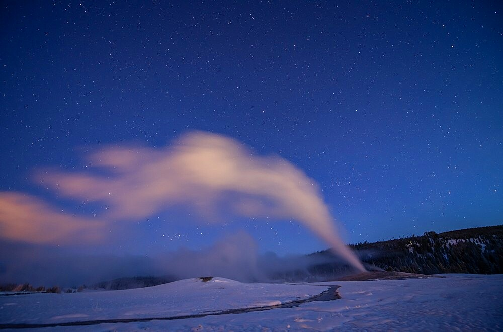 Old Faithful geyser under a starry sky, Yellowstone National Park, Wyoming, United States - 1335-132