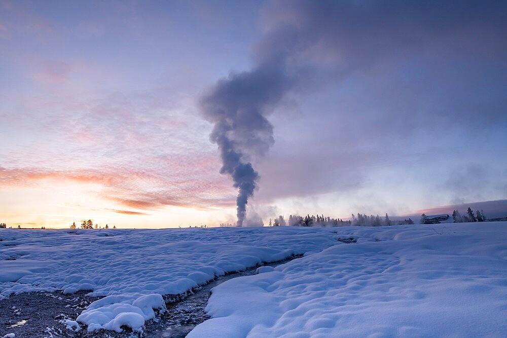 Sunrise eruption of Old Faithful geyser with stream, Yellowstone National Park, Wyoming, United States - 1335-133