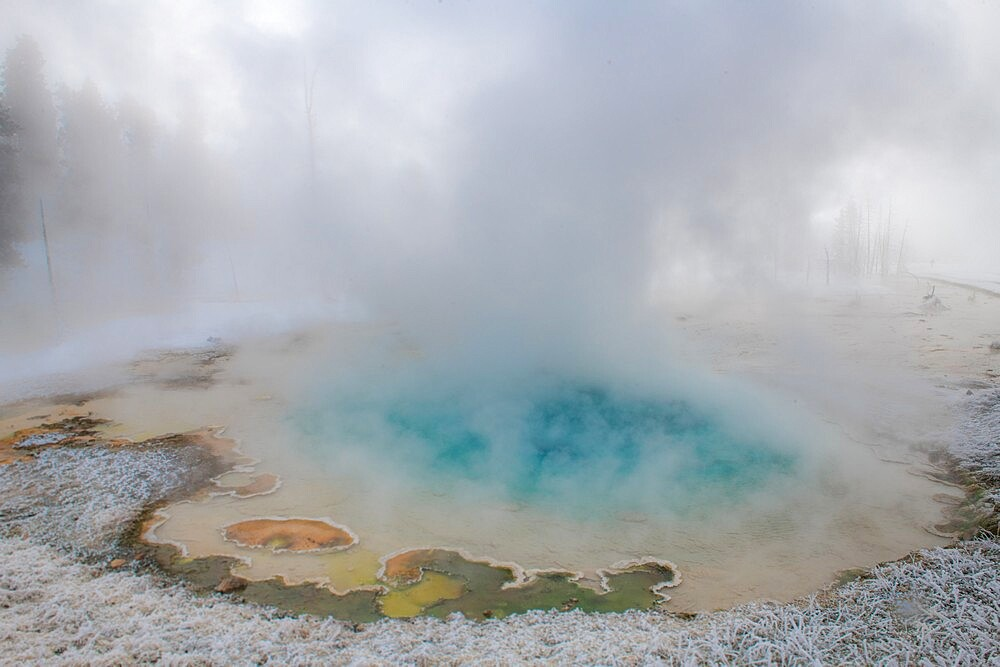 Blue thermal feature in the fog and snow, Yellowstone National Park, Wyoming, United States - 1335-138