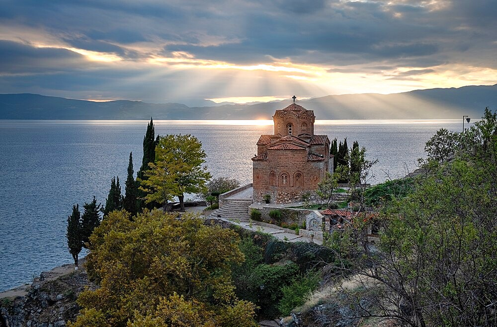 Sunset at Saint John at Kaneo. It is an Orthodox church situated on the cliff overlooking lake Ohrid, Ohrid, North Macedonia - 1336-122