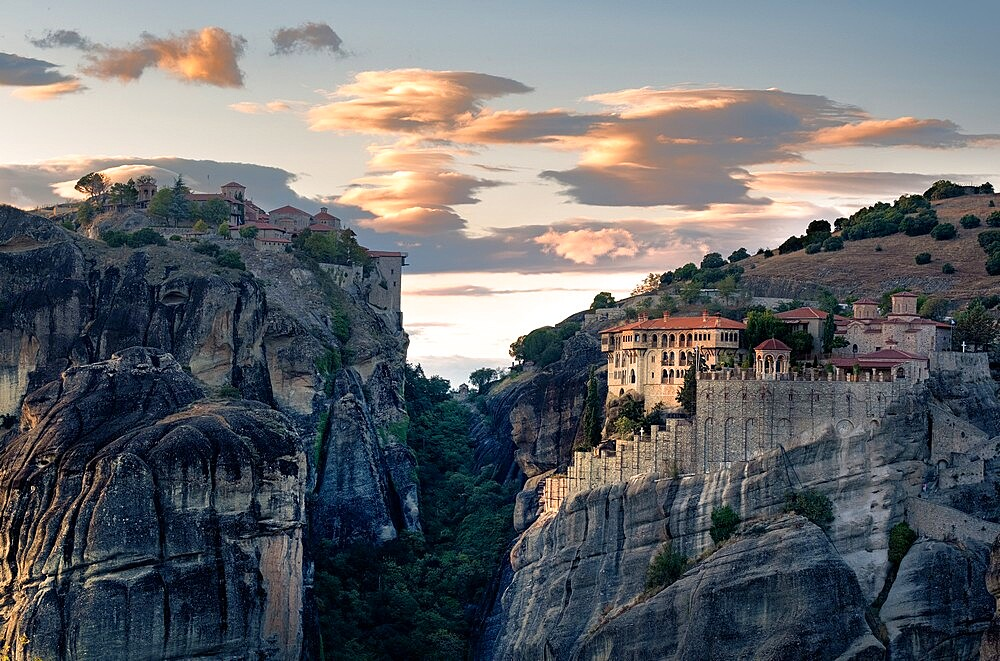 Sunset light on clouds and on Varlaam and Megalo Meteoro monasteries, Meteora, Thessaly, Greece - 1336-156