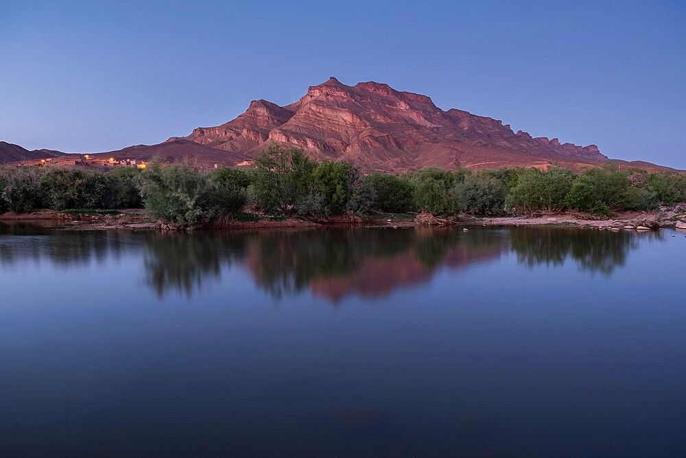 Blue hour in a oasis in the Draa valley with a calm pond and a mountain in the background, Draa valley, Morocco - 1336-183
