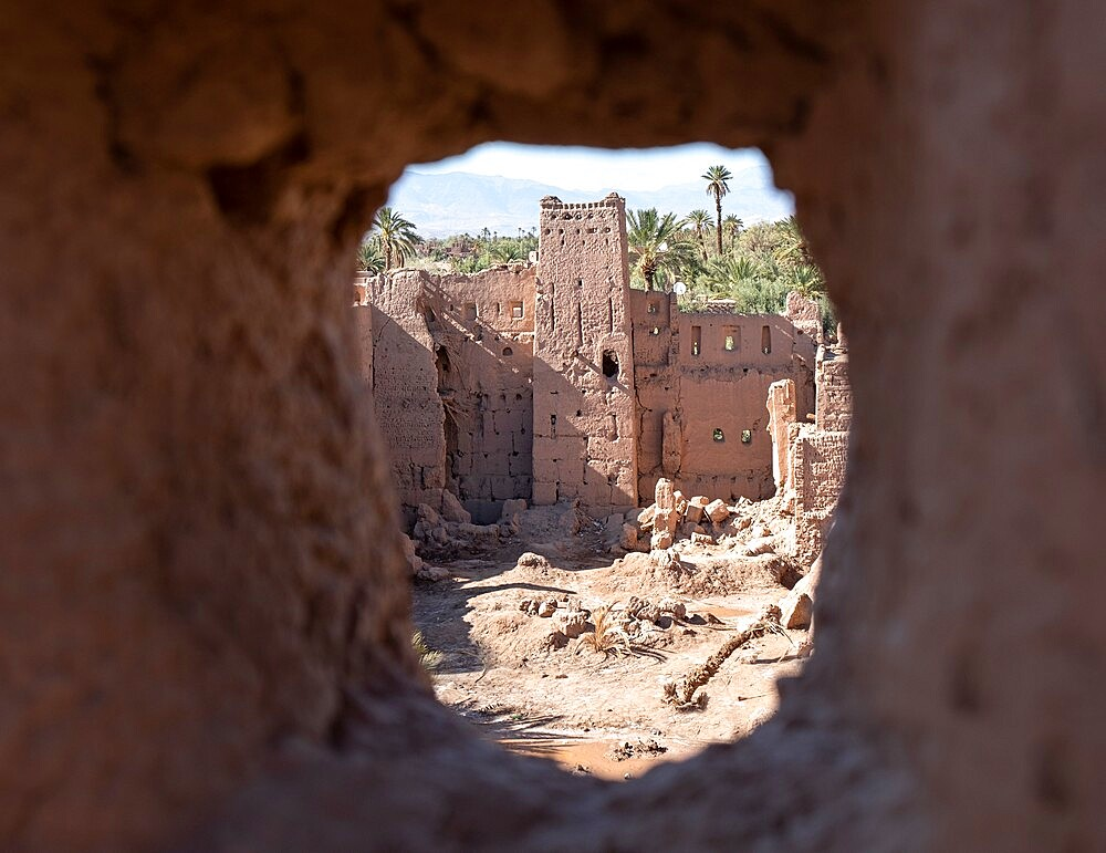 Kasbah ruins seen through an ancient kasbah window, Morocco - 1336-195