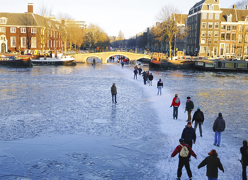 Skaters and walkers on frozen Amstel River,Amsterdam, Netherlands - 149-2068