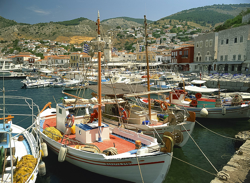 Fishing boats in the harbour, with the town behind and hills in the background on Hydra, Argo Saronic Islands, Greek Islands, Greece, Europe