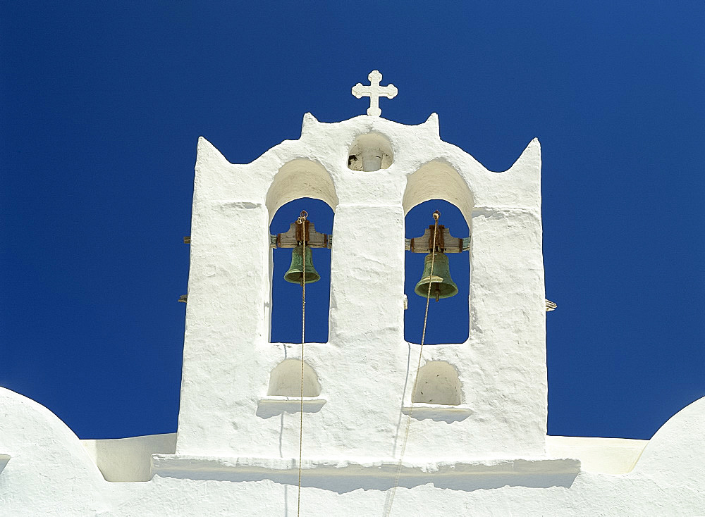 Close-up of the white walls and bells in the bell tower of the Church of Agio Constantino in Artemonas, on Sifnos, Cyclades, Greek Islands, Greece, Europe