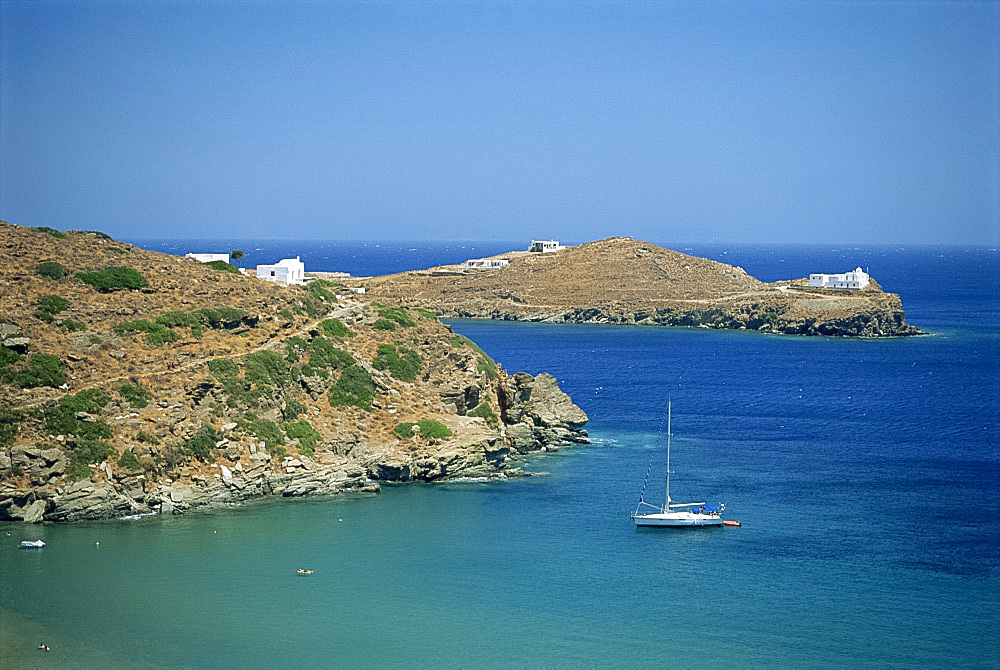 Boat and coastline of the Bay of Apokofto on Sifnos, Cyclades Islands, Greek Islands, Greece, Europe