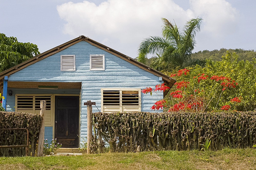 A small wooden house with traditional shutters on the windows in the countryside, Holguin, Cuba, West Indies, Central America - 149-5009