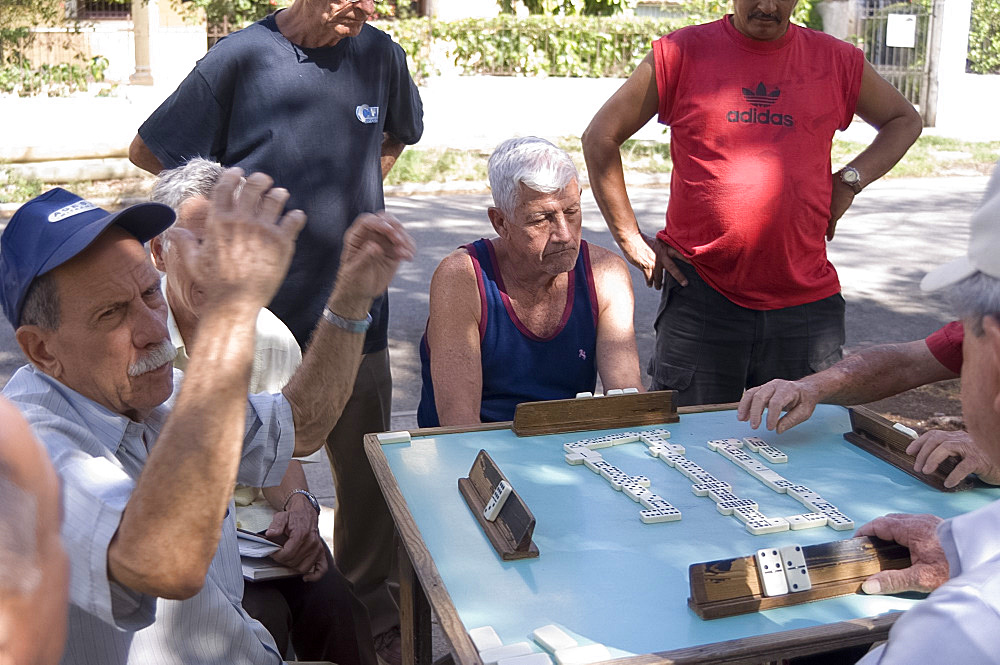 Men playing dominoes in the Vedado district, Havana, Cuba, West Indies, Central America