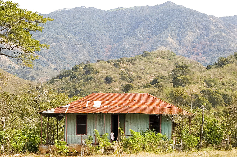 A typical tin roofed house in the mountains near Santiago de Cuba, Cuba, West Indies, Central America