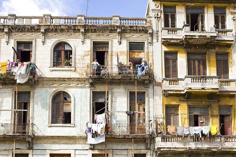 Laundry hanging from the balcony of buildings central Havana, Cuba, West Indies, Central America