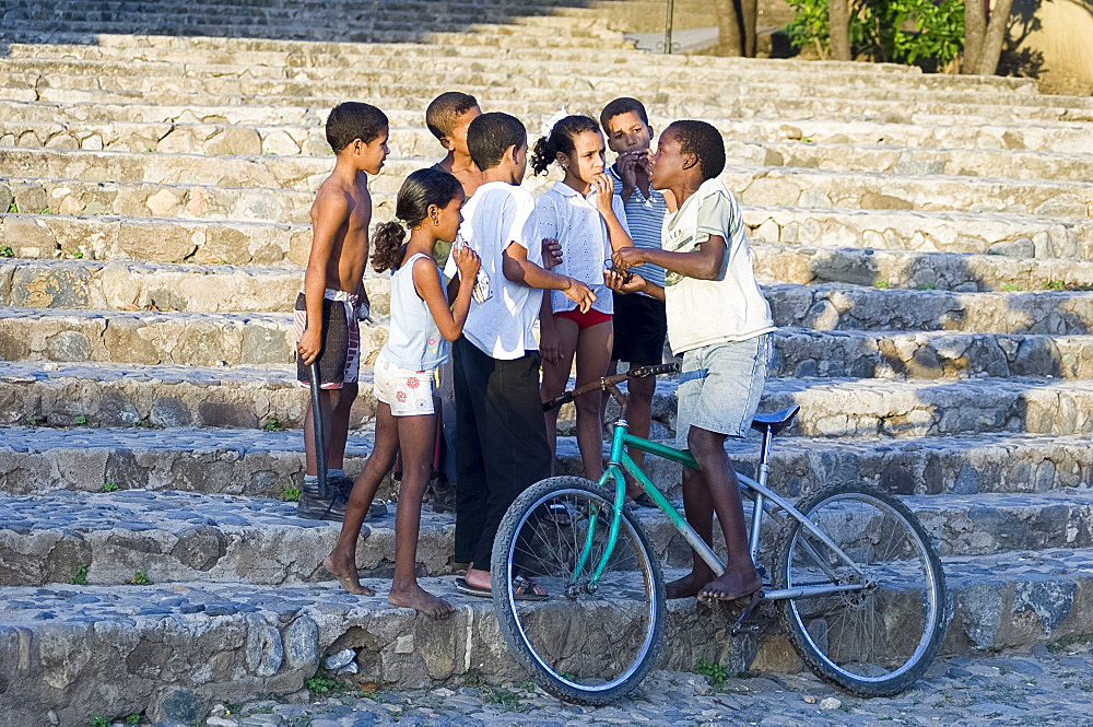 A group of children on stone steps in Trinidad, Cuba,West Indies, Central America