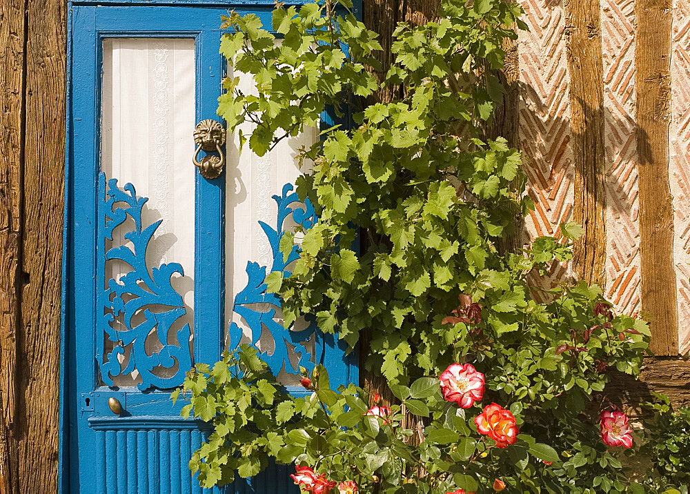 A blue painted door, Normandy, France, Europe