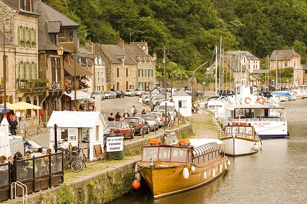 Boats on the River Rance and waterfront cafes in Port du Dinan, Brittany, France, Europe