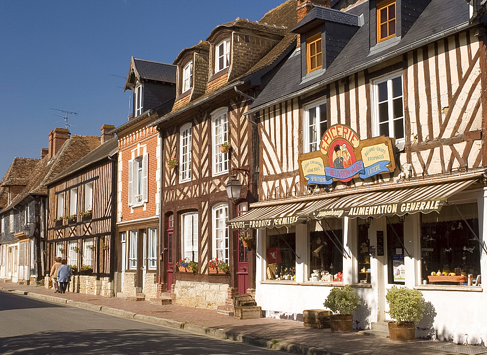 Colourful half timbered houses and shop fronts in Beauvron en Auge, Normandy, France, Europe