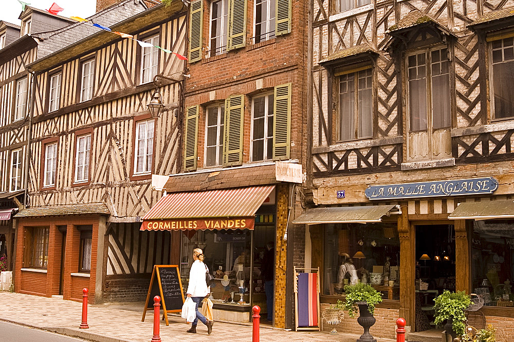Shops and half timbered buildings on the main street of Cormeilles, Normandy, France, Europe