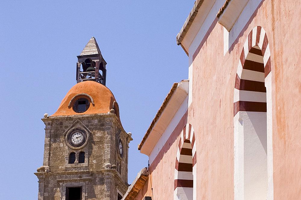 A mosque next to a church belltower in Rhodes Town, Rhodes, Dodecanese, Greek Islands, Greece, Europe