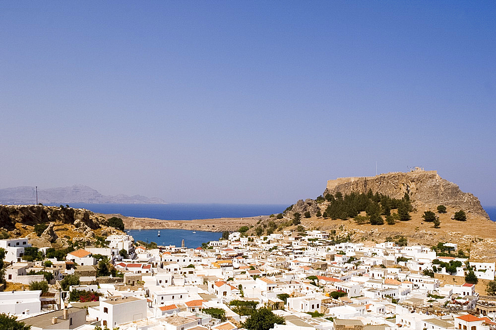 Typical Dodecanese white houses and the Acropolis in Lindos, Rhodes, Dodecanese, Greek Islands, Greece, Europe