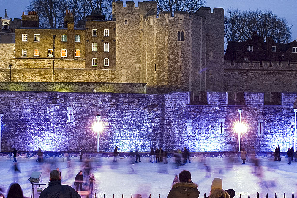 Skaters on the ice rink next to The Tower of London, London, United Kingdom, Europe