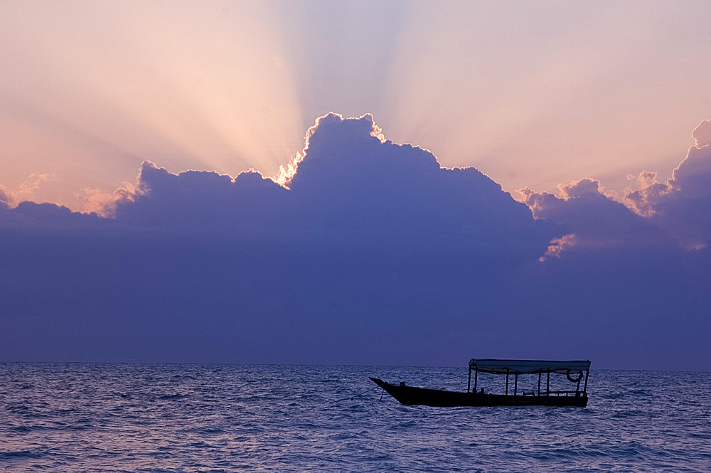 An old wooden boat in the Indian Ocean at sunrise, Paje, Zanzibar, Tanzania, East Africa, Africa