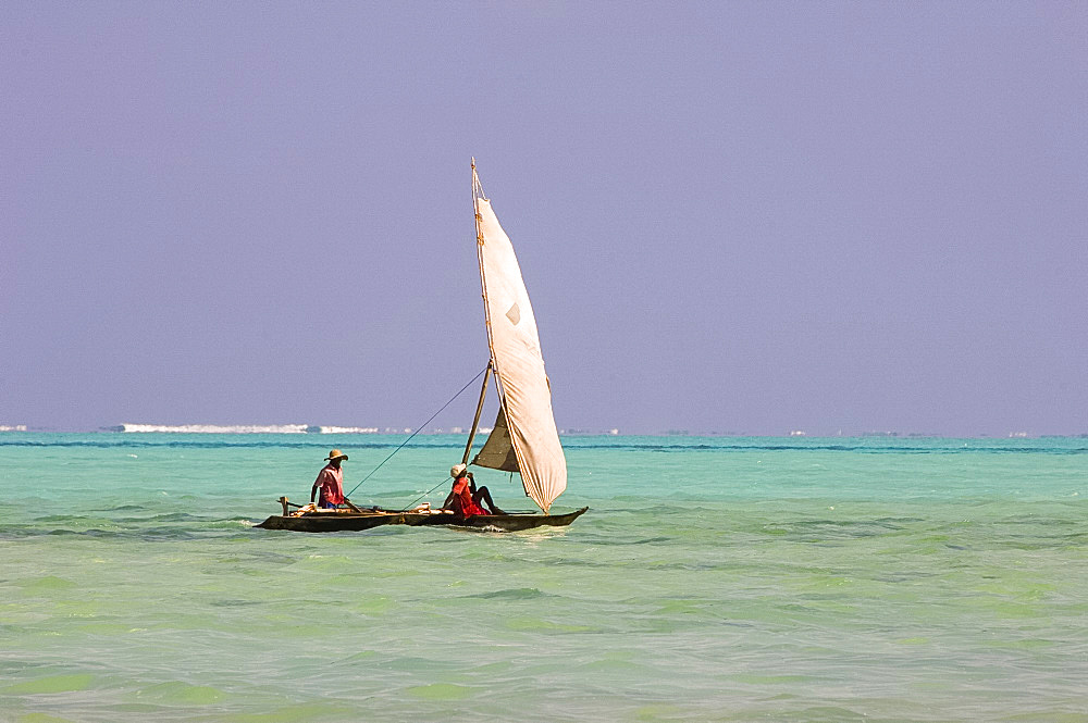 Two men on a traditional wooden dhow with sail, Zanzibar, Tanzania, East Africa, Africa