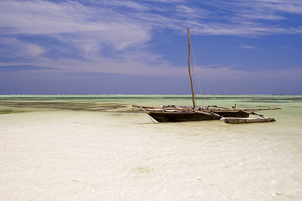 A dhow on Kiwendwa Beach at low tide, Zanzibar, Tanzania, East Africa, Africa