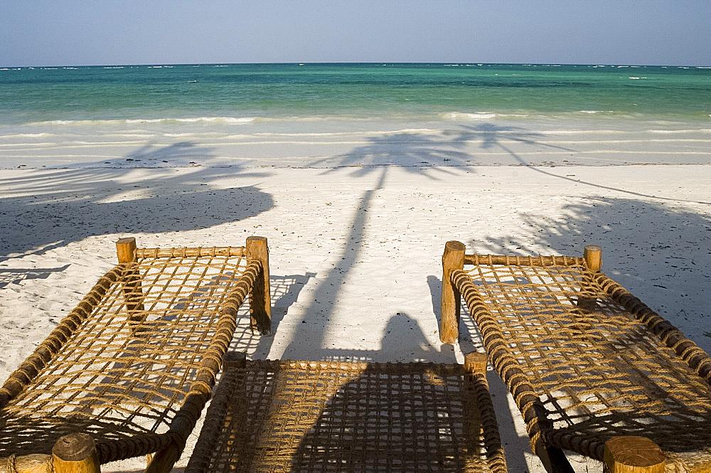 Sunbeds made from coconut wood and coir on Kiwengwa Beach, Zanzibar, Tanzania, East Africa, Africa