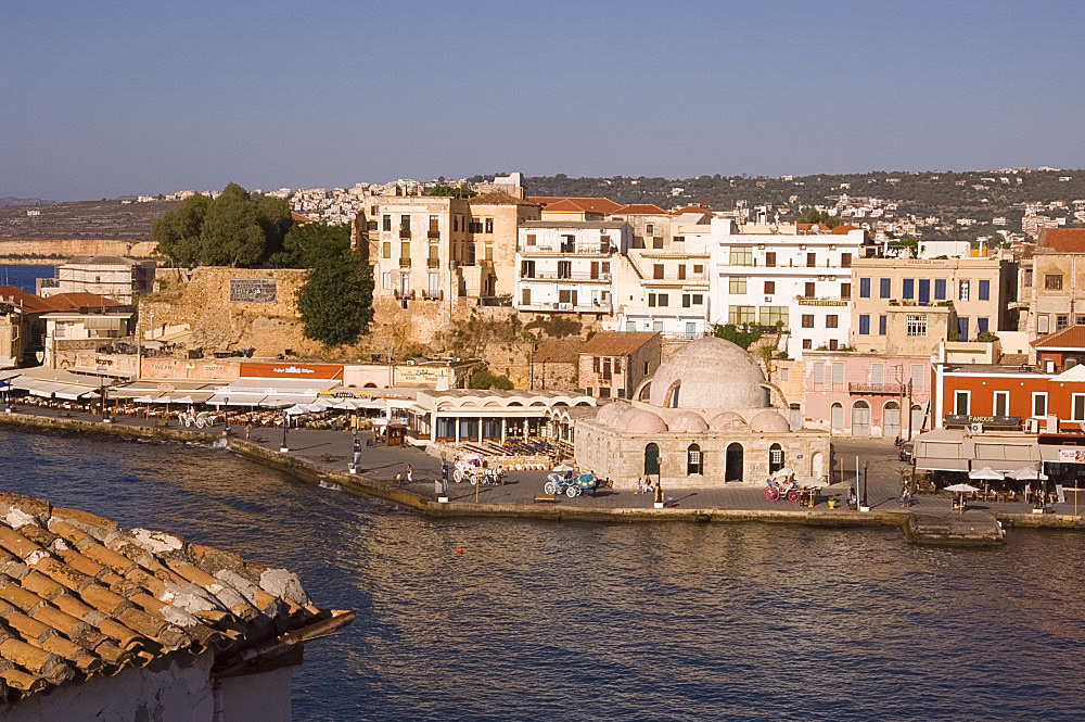 A view of tavernas around the harbour and the Kutchuk Hasan Mosque in the old town section of Hania, Crete, Greek Islands, Greece, Europe
