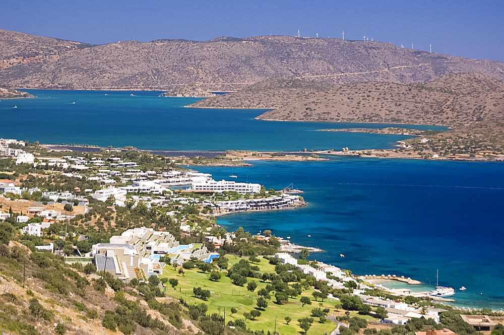 An aerial view of the coast around the resort of Elounda, Crete, Greek Islands, Greece, Europe