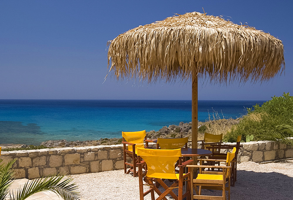 A table overlooking the beach and emerald seas at Phalassarna (Falassarna) in Western Crete, Greek Islands, Greece, Europe