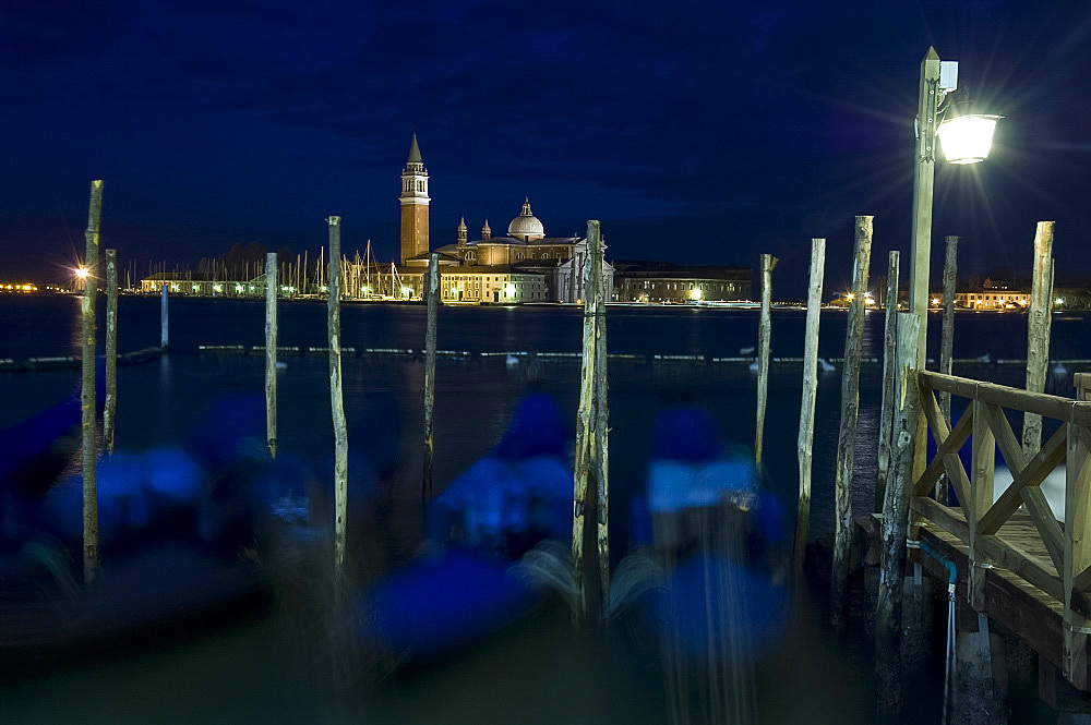 Gondolas at dusk on the Venice Lagoon and San Giorgio di Maggiore behind, Venice, UNESCO World Heritage Site, Veneto, Italy, Europe