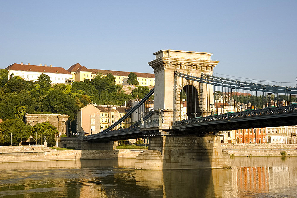 Early morning sailing under the Chain Bridge over the Danube River, Budapest, Hungary, Europe