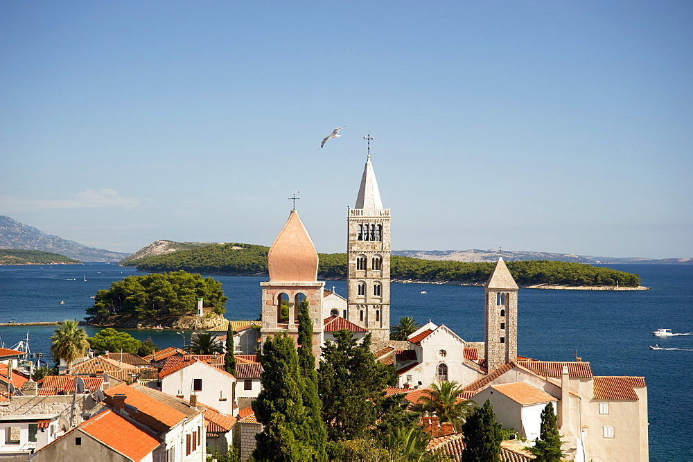 Medieval bell towers and terracotta roofs in Rab Town, island of Rab, Kvarner region, Croatia, Europe