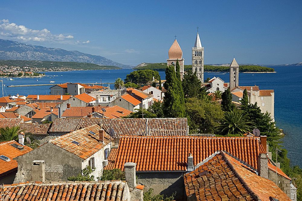 Terracotta rooftops and medieval bell towers in Rab Town, island of Rab, Kvarner region, Croatia, Europe