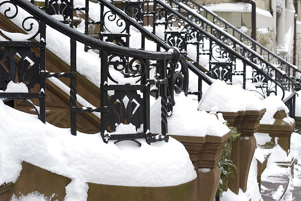 Snow on the iron railings of brownstone houses on the upper west side of Manhattan, New York City, New York State, USA