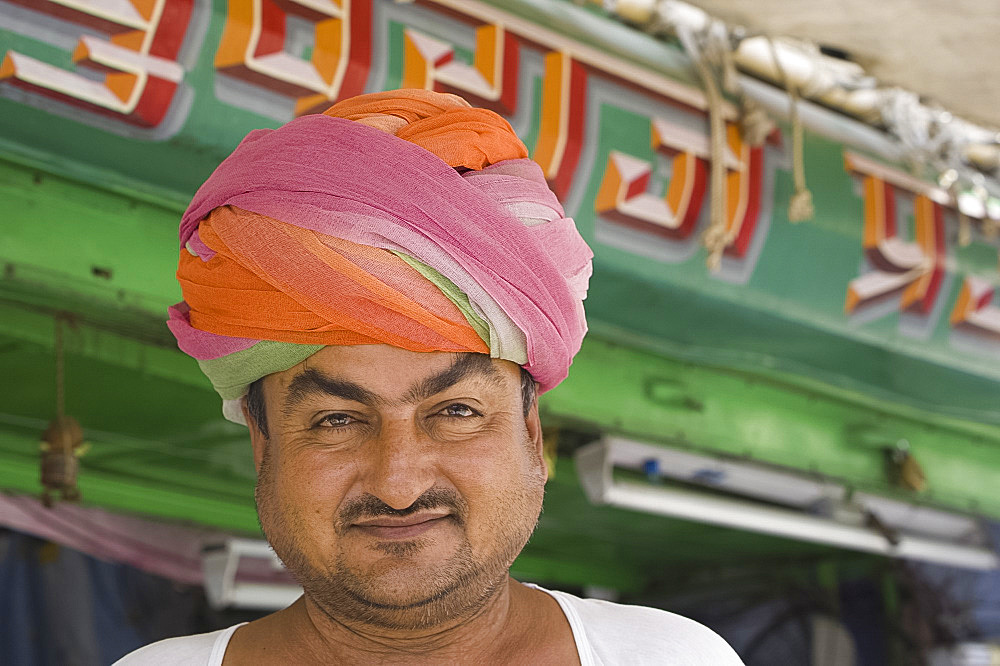 The owner of a turban shop outside his store in Jodhpur, Rajasthan, India, Asia