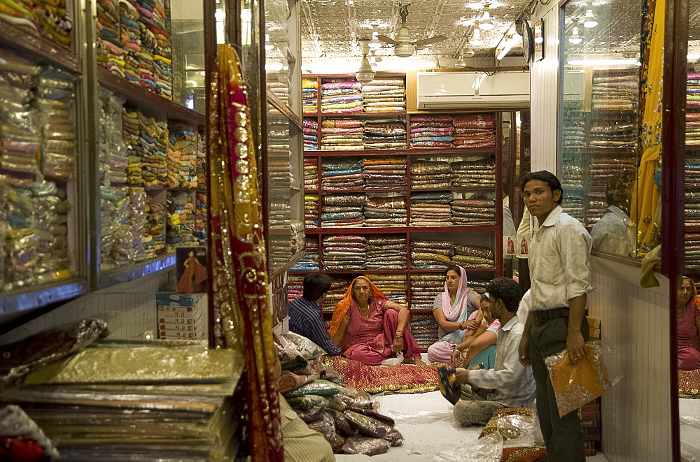 People in a sari shop in Old Delhi, India, Asia