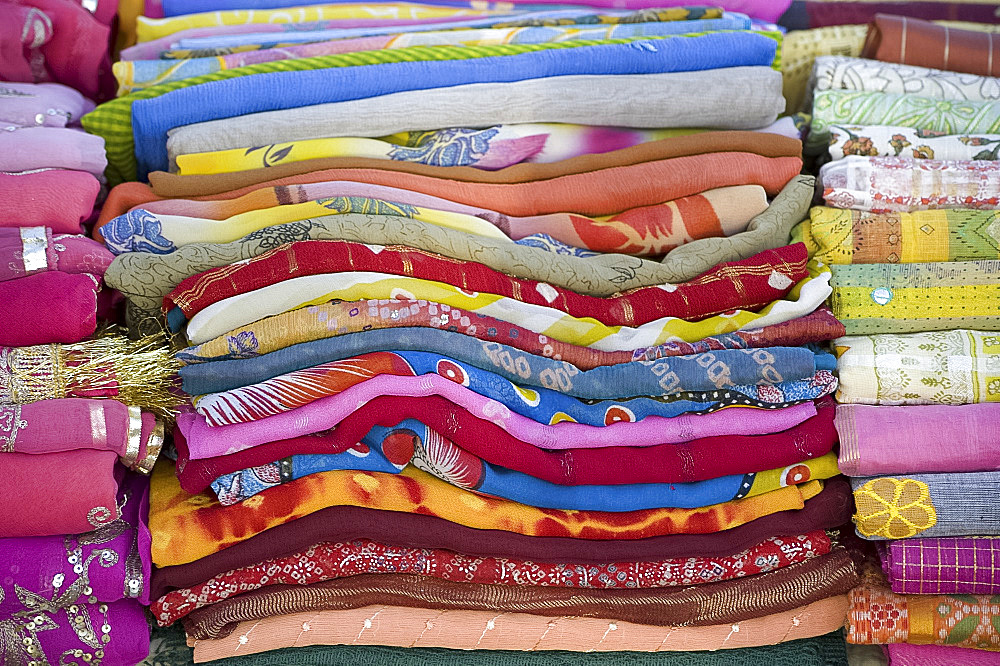 Piles of colourful scarves for sale in the Sardar Market in Jodhpur, Rajasthan, India, Asia