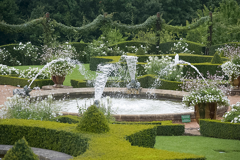 Fountains, ponds and white roses in the White Garden at Les Jardins du Manoir D'Eyrignqac in Salignac, Dordogne, France, Europe