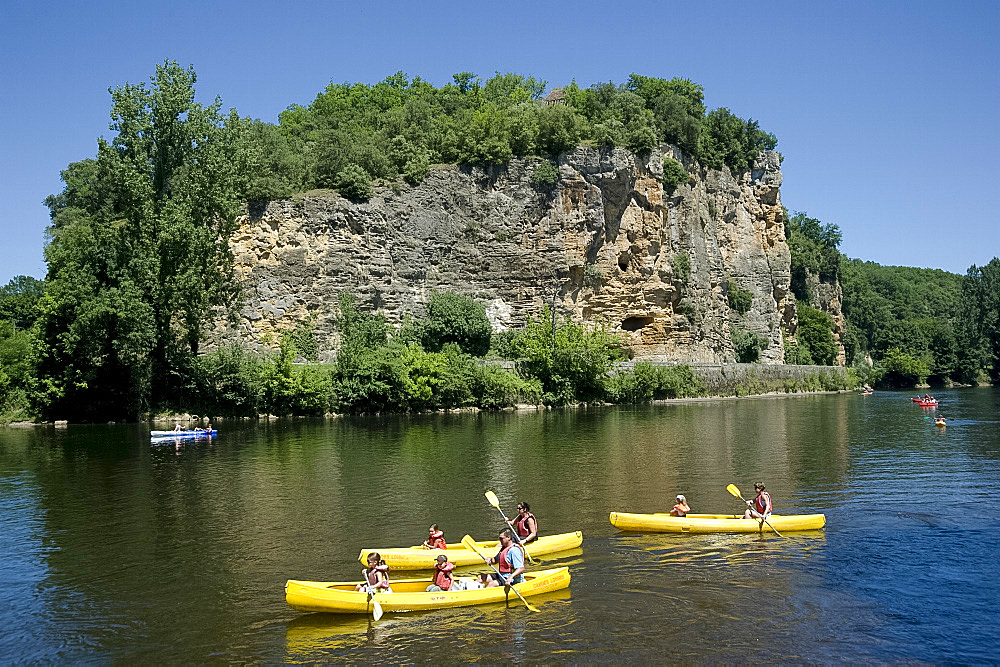 People in canoes on the Dordogne River near Kluges, Dordogne, France, Europe
