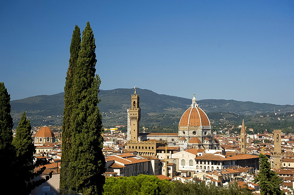 A view over teracotta rooftops to the Duomo and Campanile, Florence, UNESCO World Heritage Site, Tuscany, Italy, Europe