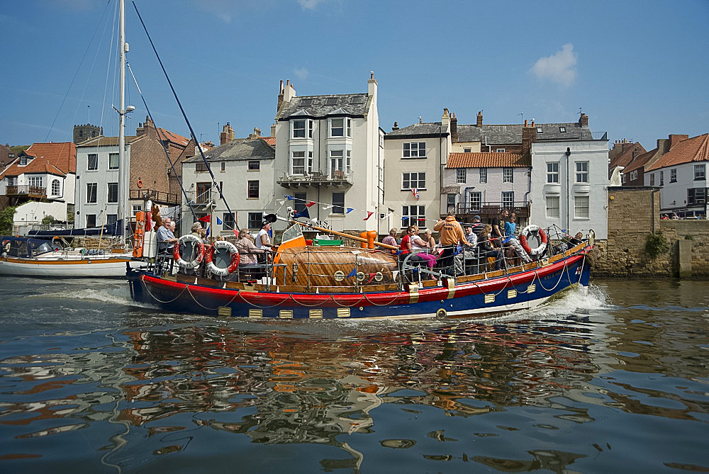A colourful wooden sightseeing boat in Whitby Harbour in Yorkshire, England, United Kingdom, Europe