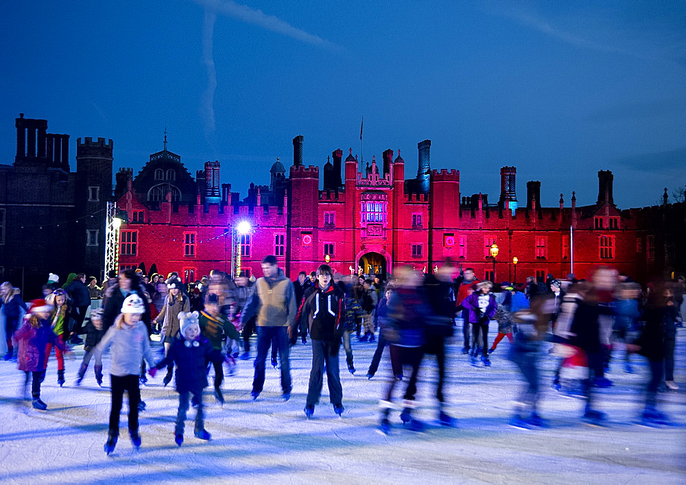 A skating rink in front of Hampton Court Palace lit with red lights, Greater London, England, United Kingdom, Europe